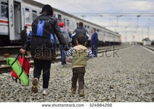 stock-photo-group-of-refugees-leaving-tovarnik-town-on-serbia-croatia-border-they-will-go-into-hungary-324984290
